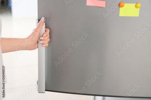 Photo  Woman opening modern fridge
