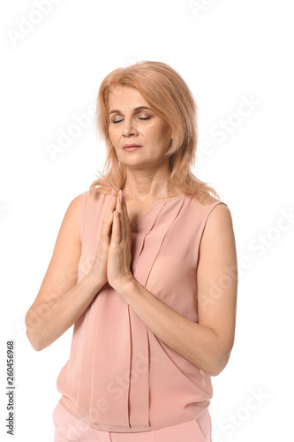 Photo Mature woman praying on white background