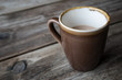 Cup of White Tea in earthen ware mug on wooden table. Rustic shabby chic look