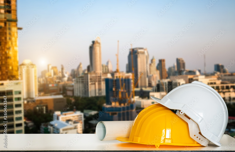 Fototapety, obrazy: Construction house and building. Repair work. Drawings for building and helmet on white table.