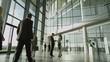 4K Business man & woman meet & shake hands in busy modern office building