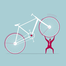 Businessman Lifts The Bicycle....