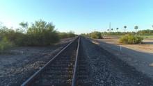 4K Pan Up Of Desert Train Tracks At Sunrise