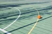 School Sport Ground Outdoor.Basketball Ball On The Empty Sport Court