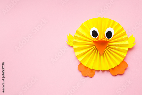 Canvas-taulu Happy, cute, yellow chick folded and created from paper on pastel pink background