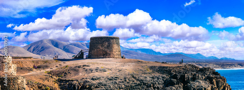 landscapes of volcanic Fuerteventura - view with Toston tower in El Cotillo. Canary islands
