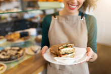 Waitress Ready To Serve Food In Cafe