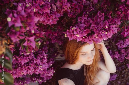 Portrait of girl with closed eyesamong purple bougainvillaea Fotobehang
