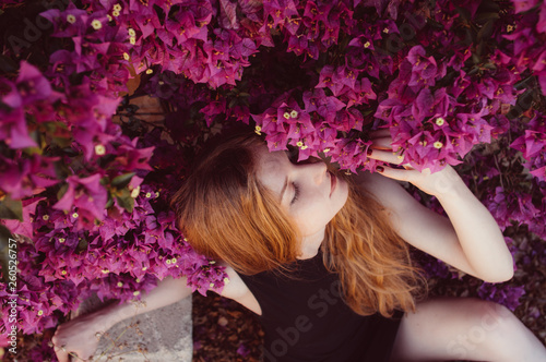 Valokuvatapetti Portrait of girl with closed eyesamong purple bougainvillaea