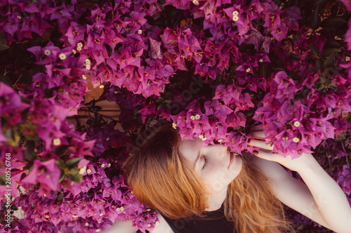Stampa su Tela Portrait of girl with closed eyesamong purple bougainvillaea