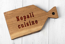 Wooden Cutting Board With Inscription. Concept Of Nepali Cuisine