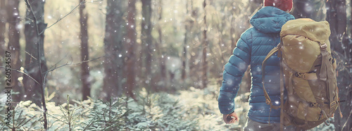 Obraz winter landscape man with a backpack / nature landscape a man on a hike with equipment in snowy weather in Canada - fototapety do salonu