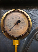 An Old Brass Pressure Meter Wi...
