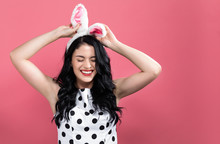 Young Woman With Easter Rabbit Ears On A Pink Background
