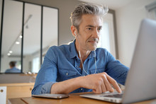 Mature Man On Video Call Working From Home