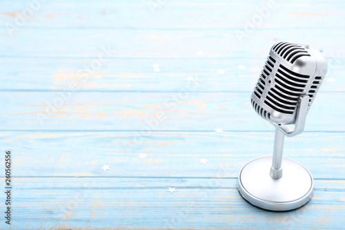 Valokuva  Vintage microphone on blue wooden table
