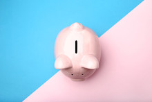 Pink Piggy Bank On Colorful Background