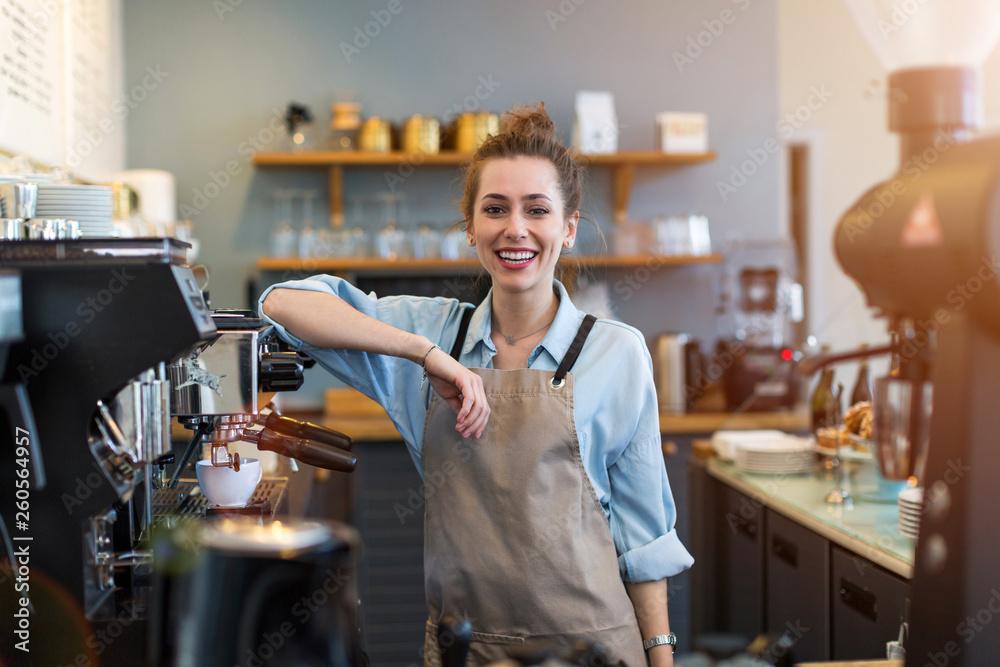 Fototapeta Woman working in coffee shop