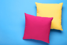 Soft Colorful Pillows On Blue ...