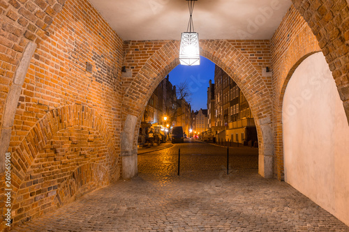 Beautiful gate to the old town of Gdansk at night, Poland.