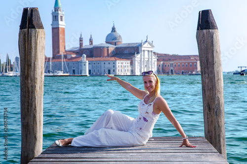 Stickers pour portes Venise Happy beautiful girl against the background of turquoise water at the Grand Canal next St Marks Square in Venice, Italy.Concept of traveling and vacation in summer Venice.