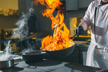 Chef Is Stirring Vegetables In Wok.