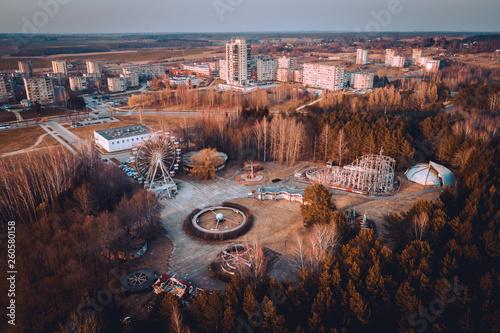 Fotografie, Obraz  Abandoned carousel park and panorama of Elektrenai city