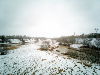 Misty day with a light snow rain in Koroinen, Turku, Finland. Place were vähäjoki and Aurajoki river meet. Area is old and known as one of the first places with human settlements in Finland.