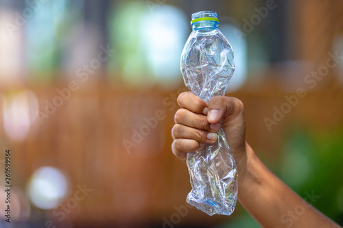 Photo  Hand squeeze plastic bottle