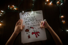 Young Boy Faceless Writing A Letter To Santa Claus For Christmas