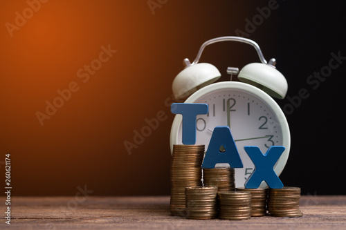 Time to pay TAX concept  TAX alphabet with stack of coin and