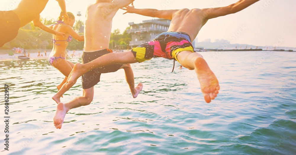 Fototapety, obrazy: Group of happy crazy people having fun jumping in the sea water from boat. Friends jump in mid air on sunny day summer pool party at diving holiday. Travel vacation, friendship, youth holiday concept.