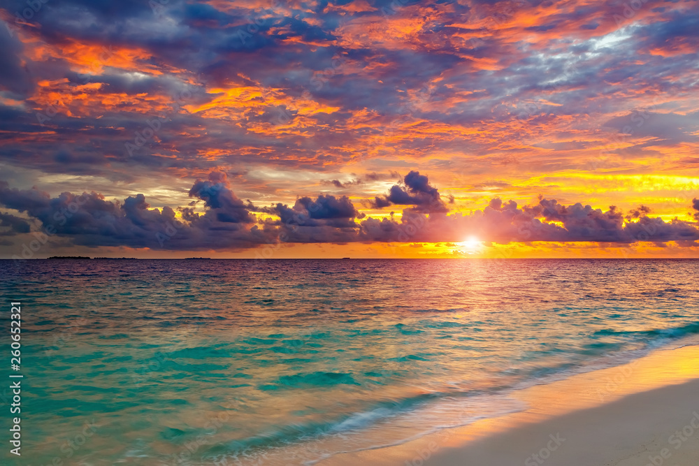 Fototapeta Colorful sunset over ocean on Maldives