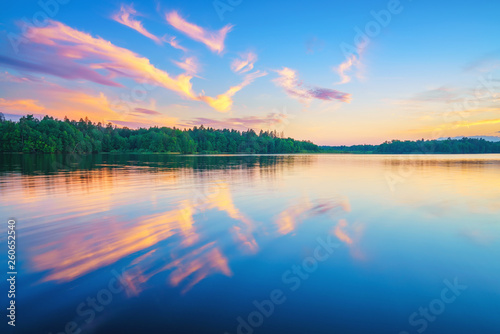 Poster Rivière de la forêt Beautiful landscape with colorful sunset over forest lake