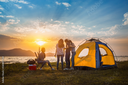 Poster Camping Group of asian women party with drink bottles enjoy travel camping,trekking in vacation time at sunset.