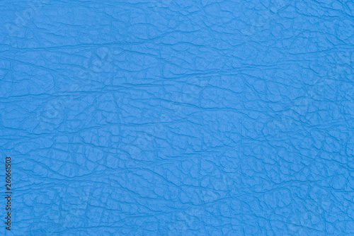 Fotografiet  Surface faux leather with creases in blue color as background or texture
