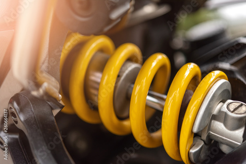 Closeup of springs, yellow shock absorbers motorcycle big bike, selective focus Canvas Print