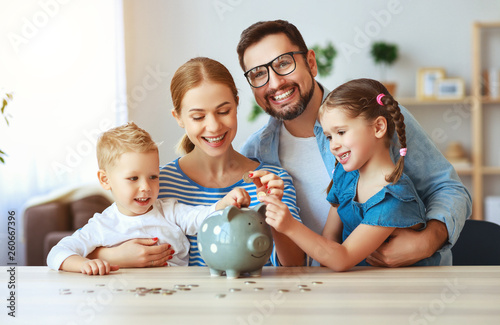 Valokuva financial planning   family mother father and children with piggy Bank at home