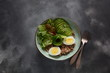 Vegan Buddha bowl with buckwheat, avocado, boiled eggs, cucumber, arugula beet leaves. Diet, detox, healthy food concept