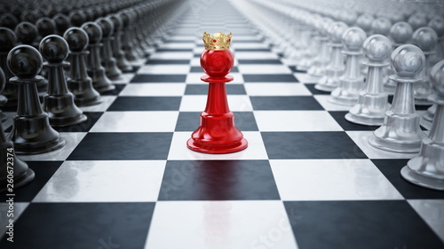 Fotografie, Obraz  Red chess pawn wearing a crown standing between black and white chess pieces