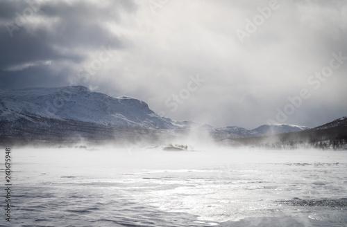 Stickers pour portes Eau Wind an clouds over a frozen river in Sarek. Lapland, Sweden.