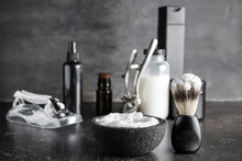 Foam With Shaving Brush On Dark Table