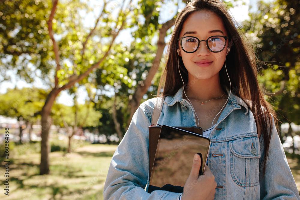 Fototapeta Portrait of an asian college girl