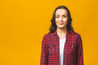 Leinwanddruck Bild - Portrait of a pretty smiling woman in casual posing isolated on a yellow background.