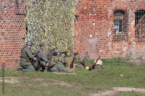 German soldiers defend the fortress Reconstruction of the assault
