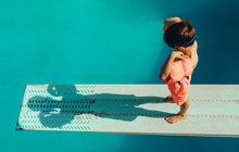 Boy Learning Diving At Pool