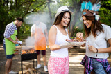 Happy friends camping and having a barbecue in nature - 260689197