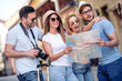 Group of tourist with map