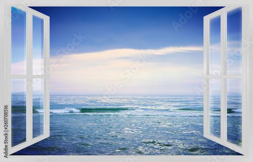 Fotografia  Calm sea in a sunny day - concept image seen from a white window