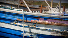 Closeup Of A Multi Colored Boat With Weathered And Peeling Paint In Scotland
